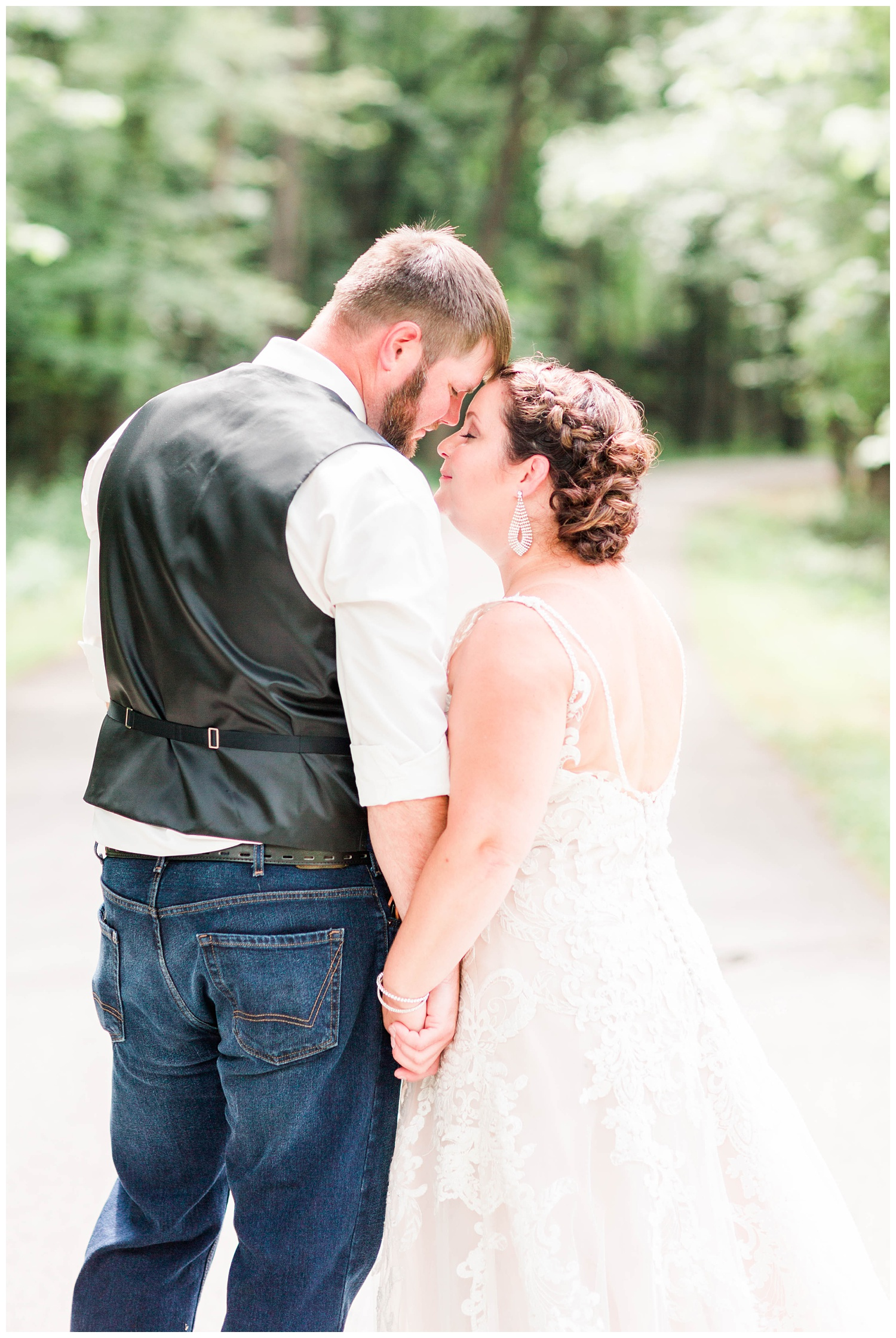 Bride and groom stand intimately close on a pathway in Call Park in Algona, Iowa   CB Studio