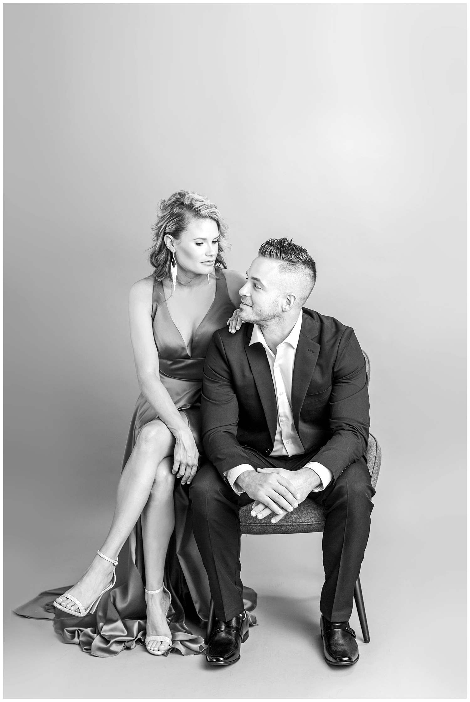 Glamorous Vanity Fair cover model couple pose in high fashion formal attire | Iowa Wedding Photographer
