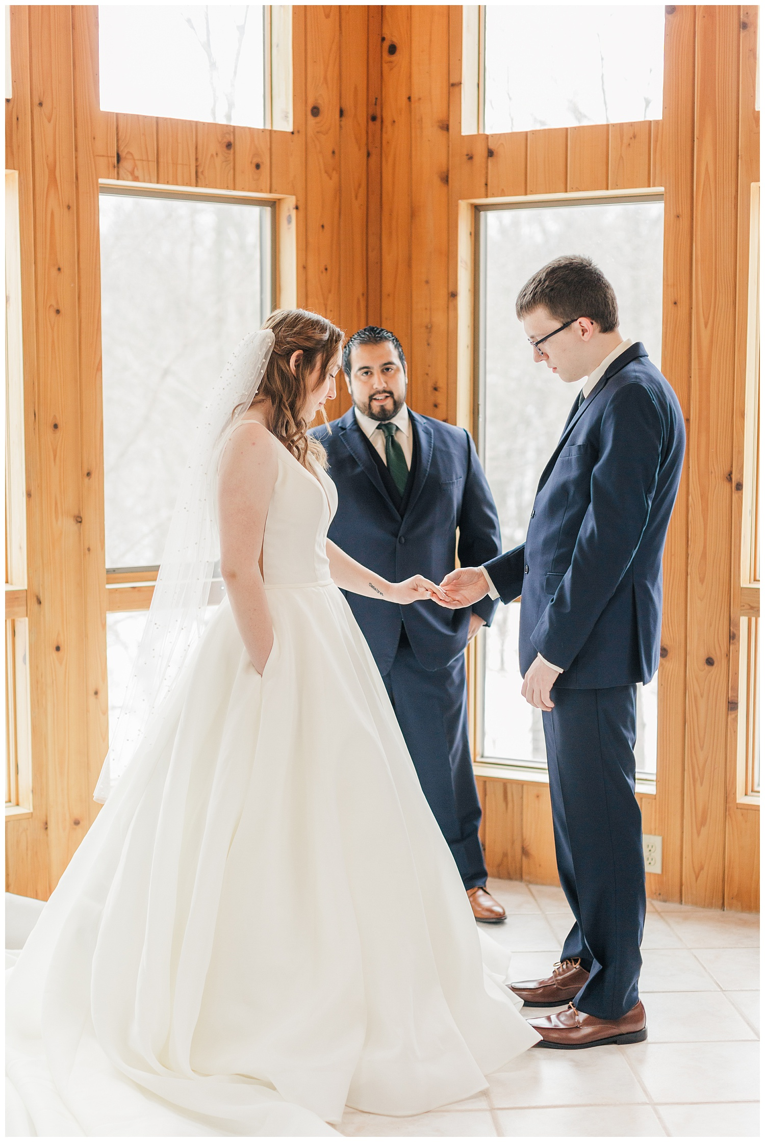 Raven and Tyler are wedded in their family's sunroom on an Iowa winter day in January | CB Studio