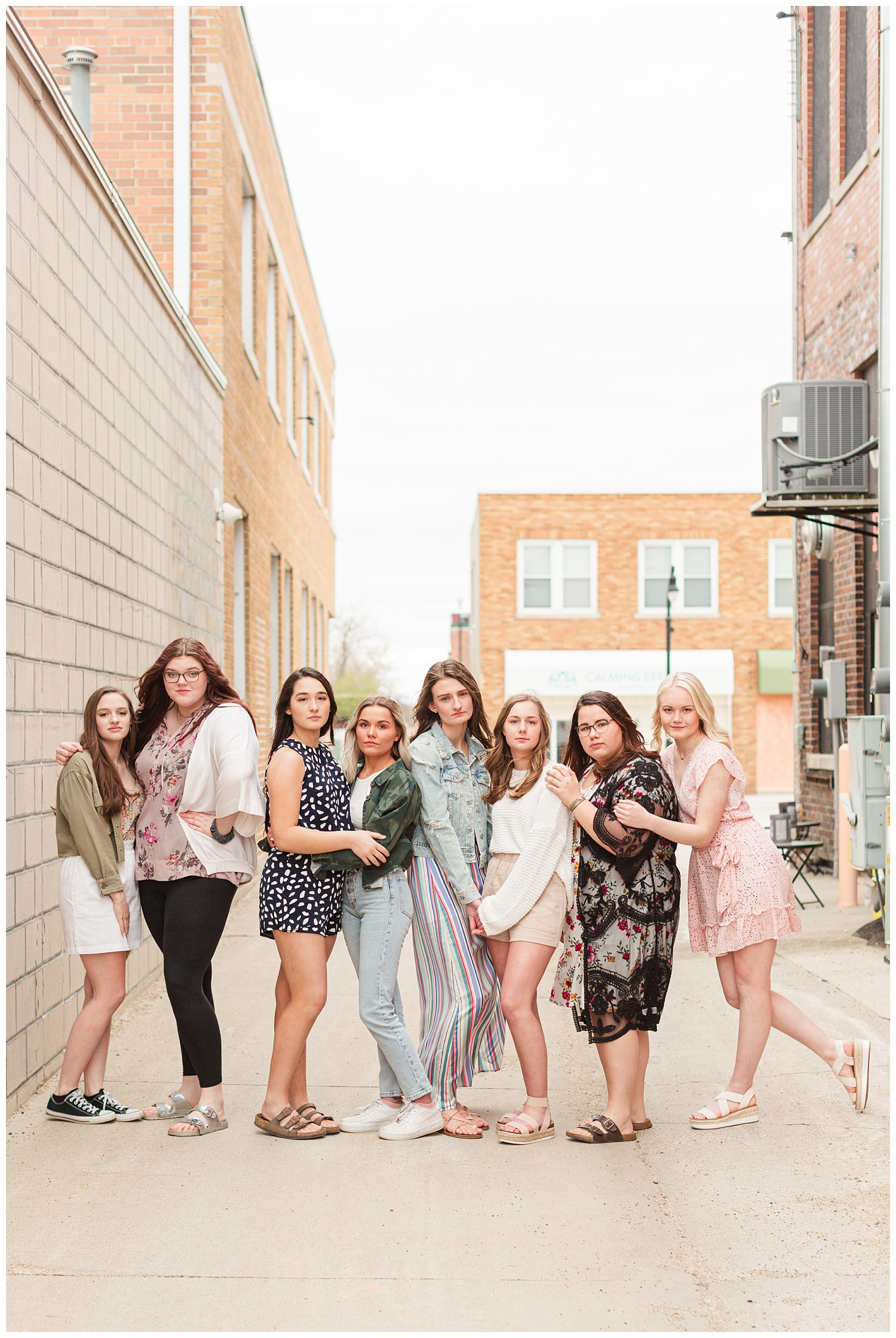 2022 CBS Senior Spokesmodel Team pose downtown Algona, Iowa. Styled in outfits from Cultivate Boutique | CB Studio