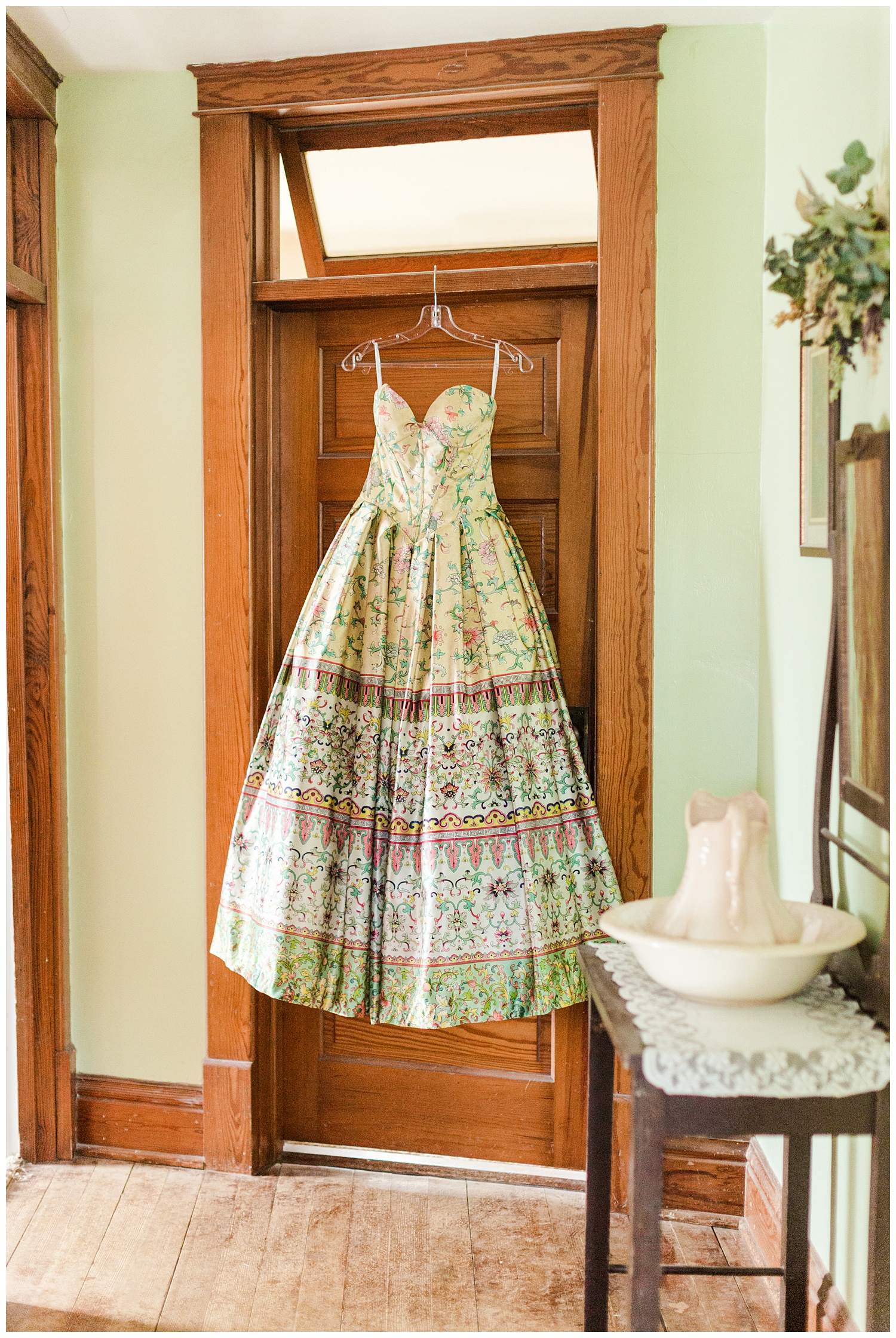 Michaela's vintage style prom dress hangs from a wooden door in an 115 year old home | CB Studio