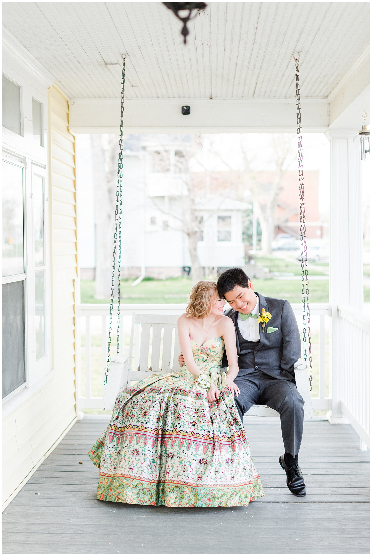 Sam and Michaela snuggle together on a white porch swing as they wait to attend 2021 Prom | CB Studio