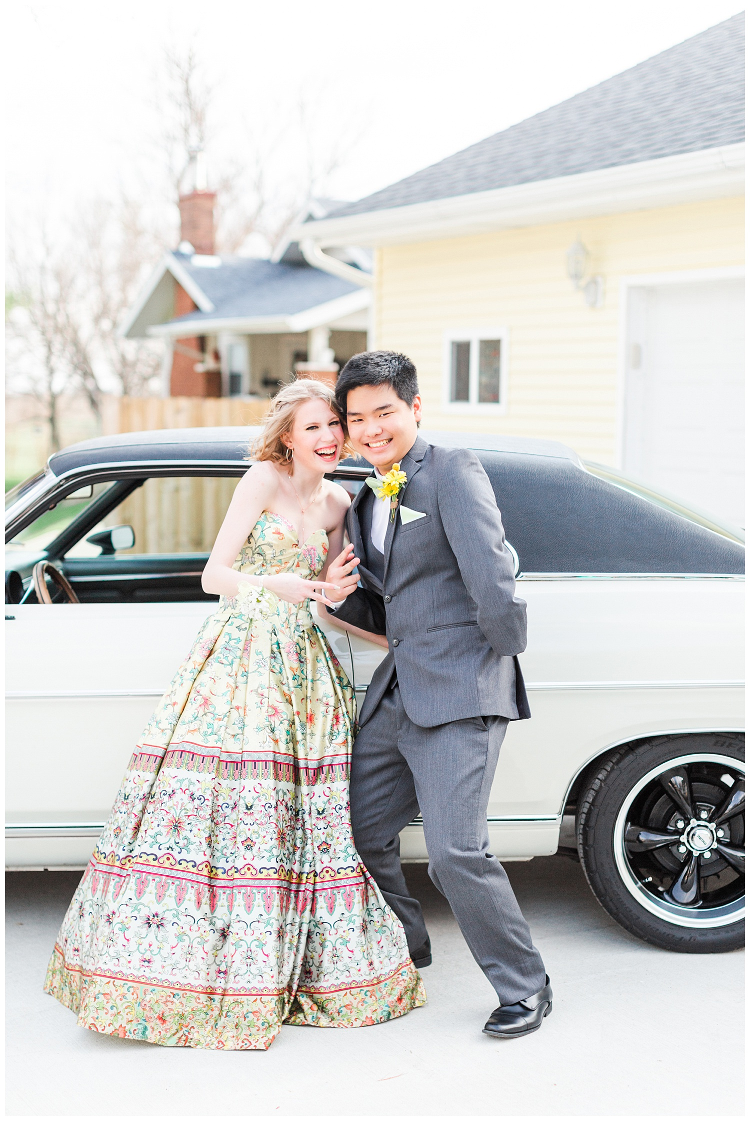 Michaela and Sam flash a peace sign as they are about to hop into a vintage and drive off to prom | CB Studio