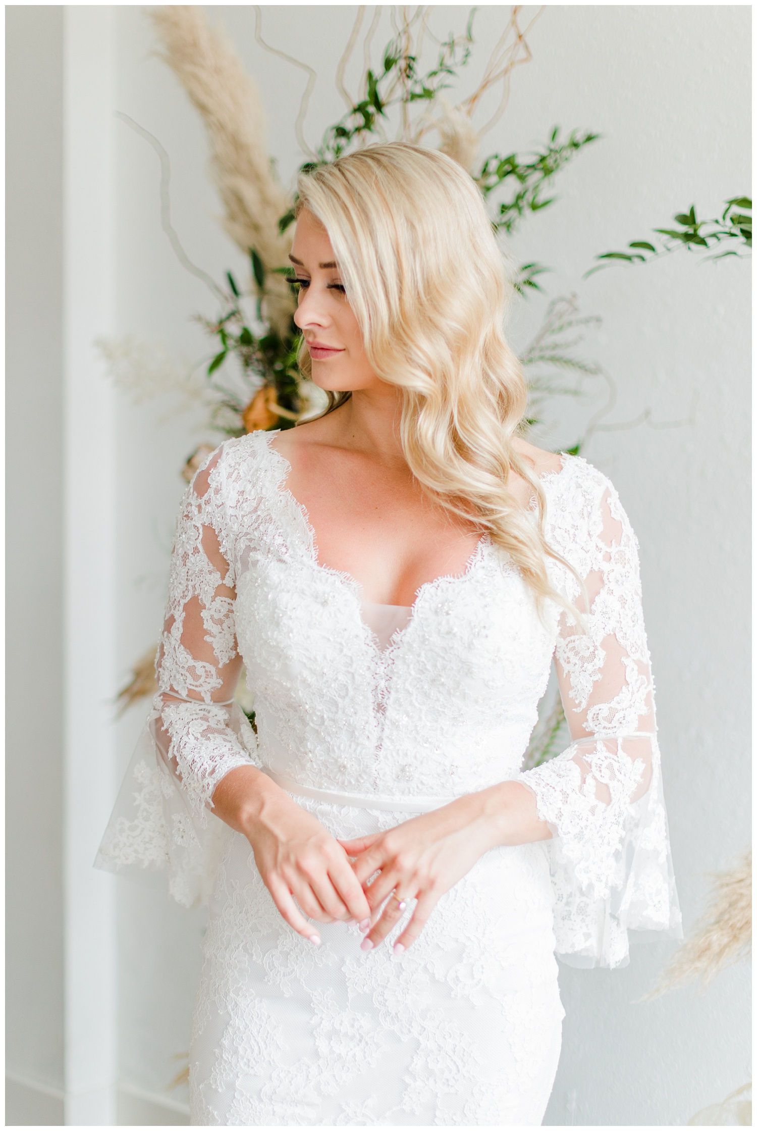 Beautiful bride, Kyarsten, wearing a boho style Casablanca gown with lace elbow poet sleeves | CB Studio