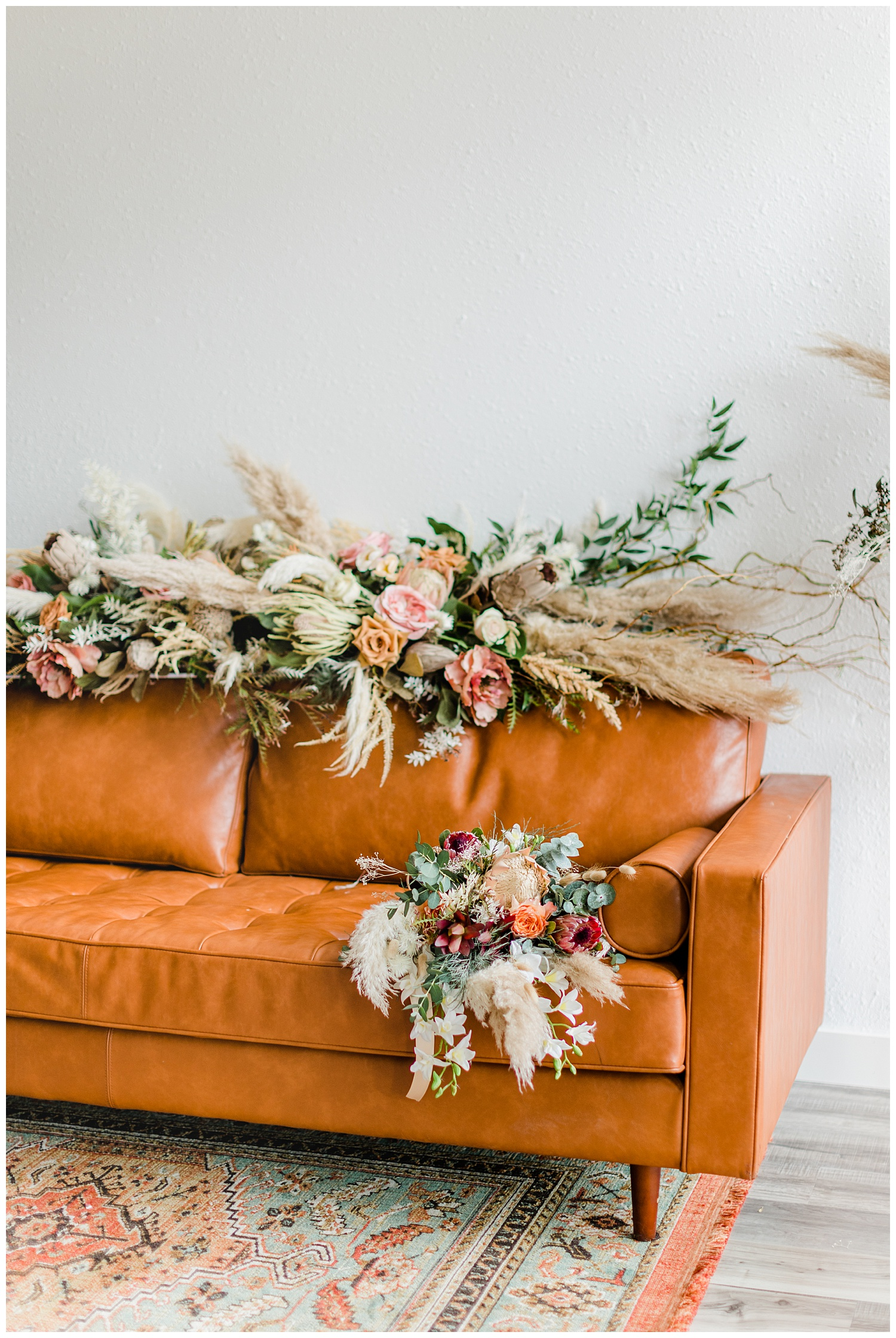 Vintage Boho floral couch arrangement and bridal bouquet complete with pampas grass, roses, eucalyptus and other dried florals | CB Studio