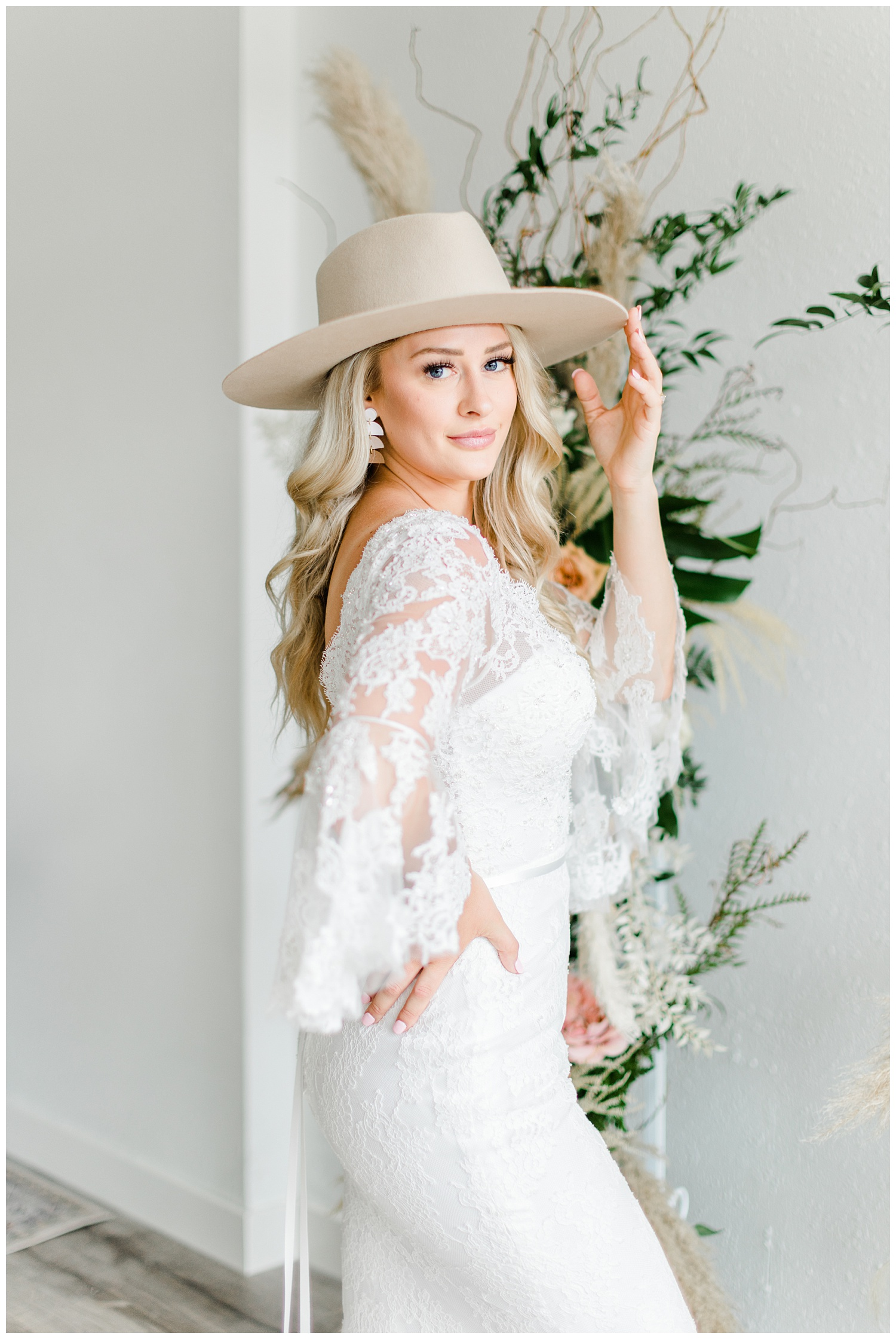 Beautiful bride, Kyarsten, wearing a boho style Casablanca gown with lace elbow poet sleeves and a Gigi Pip hat | CB Studio