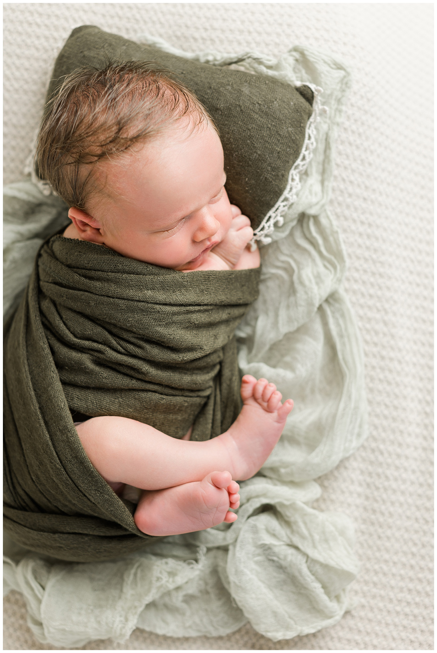 Baby Connor swaddled up in olive green   CB Studio