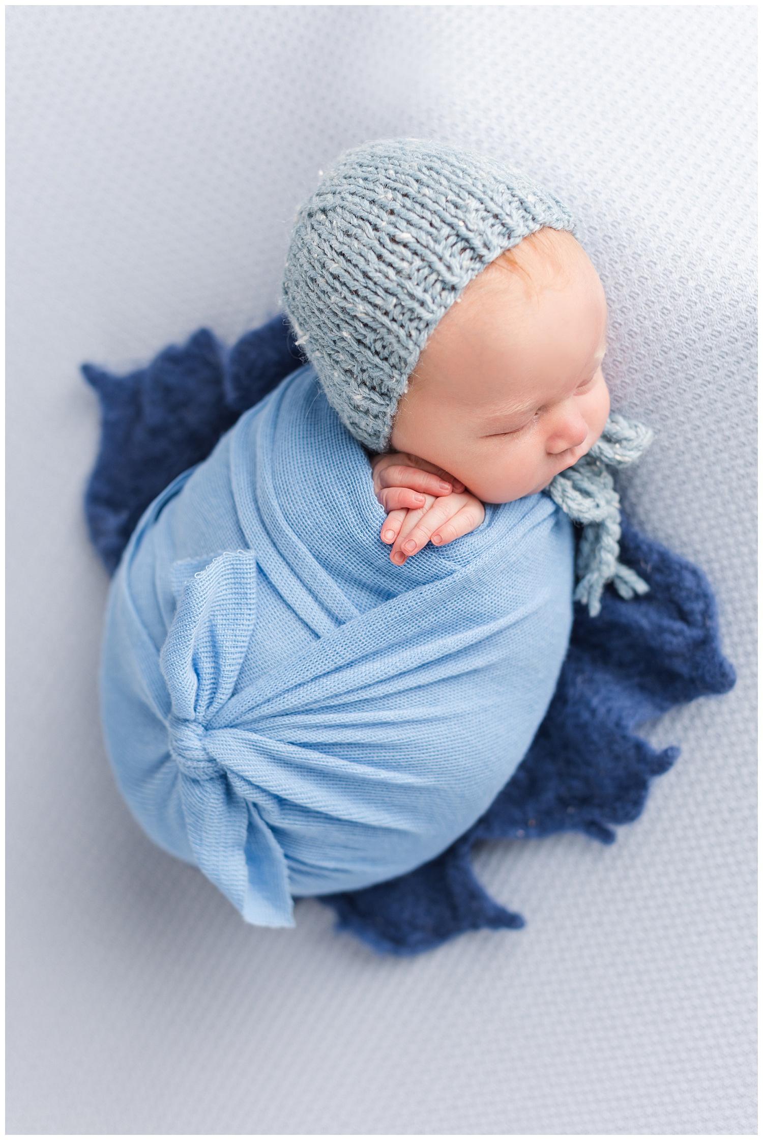 Newborn baby Luka wrapped in shades of blue   CB Studio