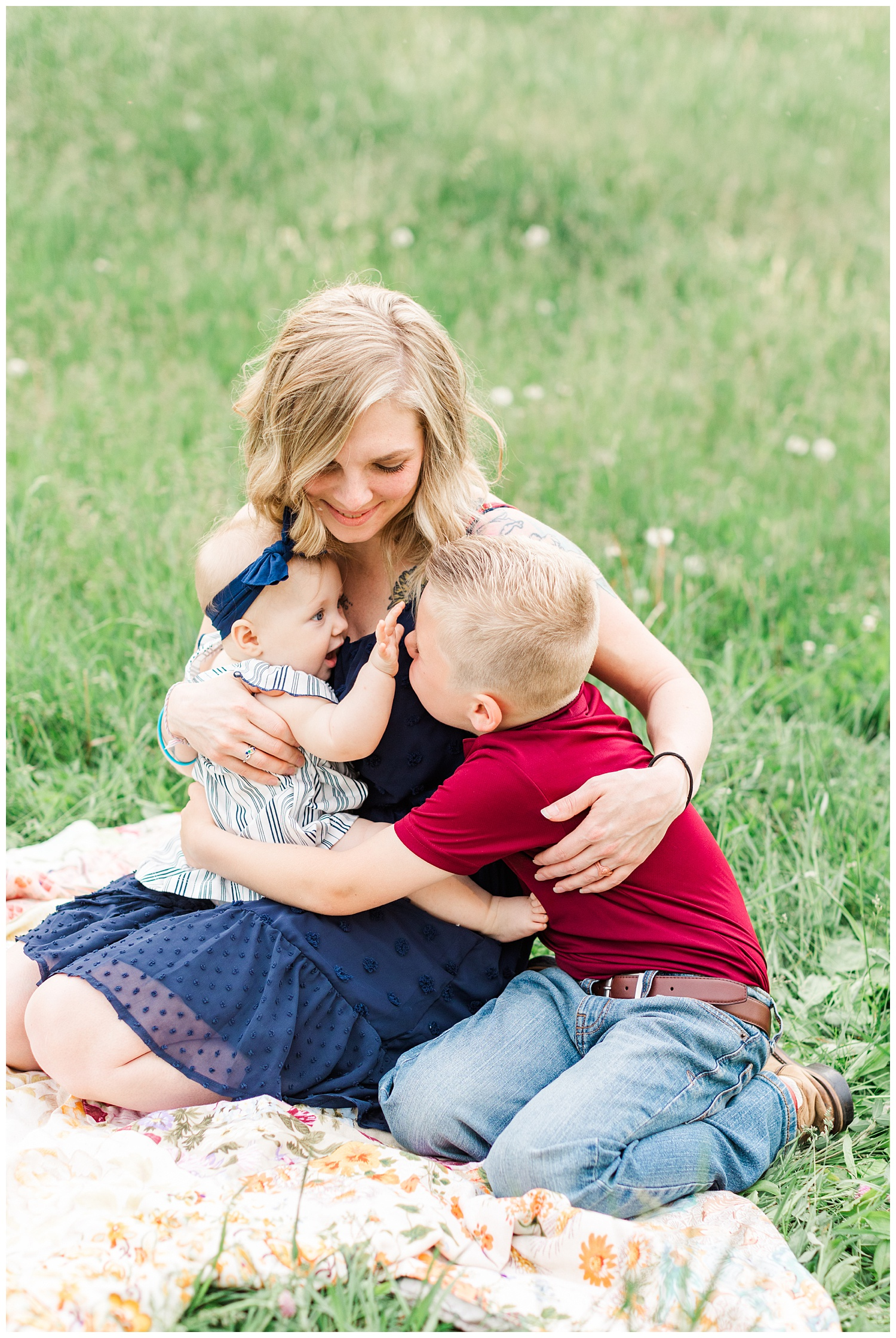 Mama embraces her two children in a grassy pasture in Iowa | CB Studio