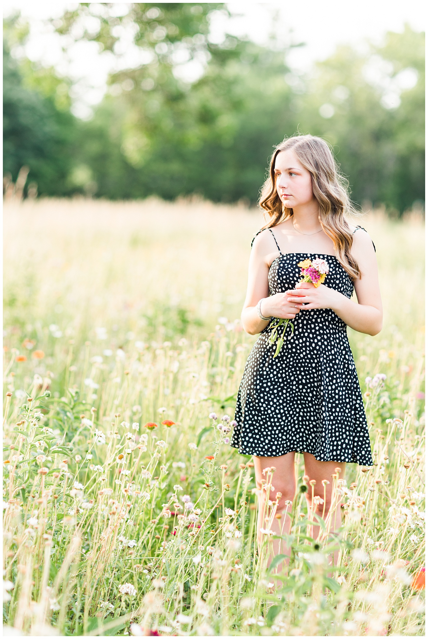 Senior Taylor stands in a field of wildflowers | CB Studio