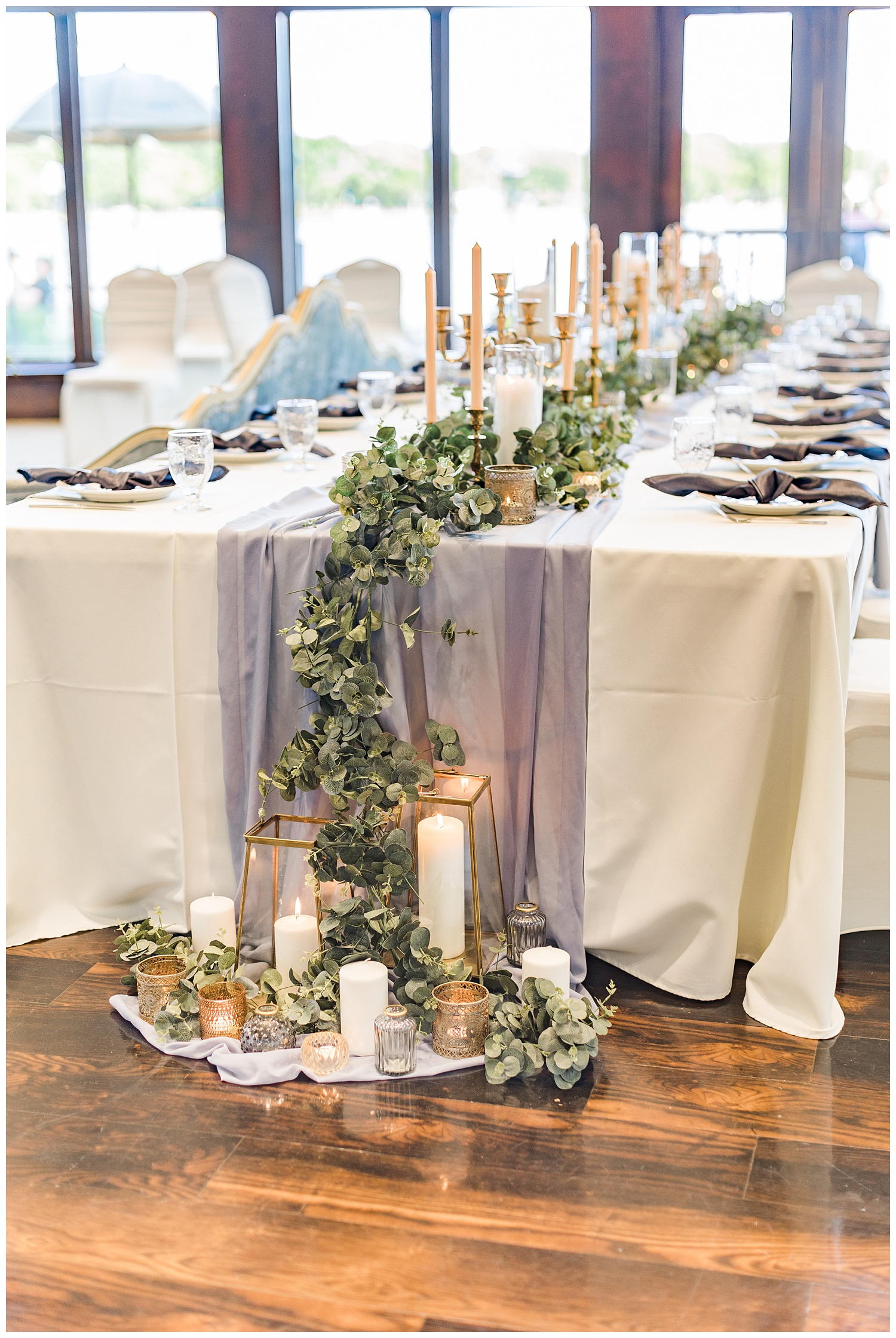 Dusty blue and peach kings wedding table topped with gold vintage candlesticks and eucalyptus with the decor draping to the floor at the Shores at Five Island | CB Studio