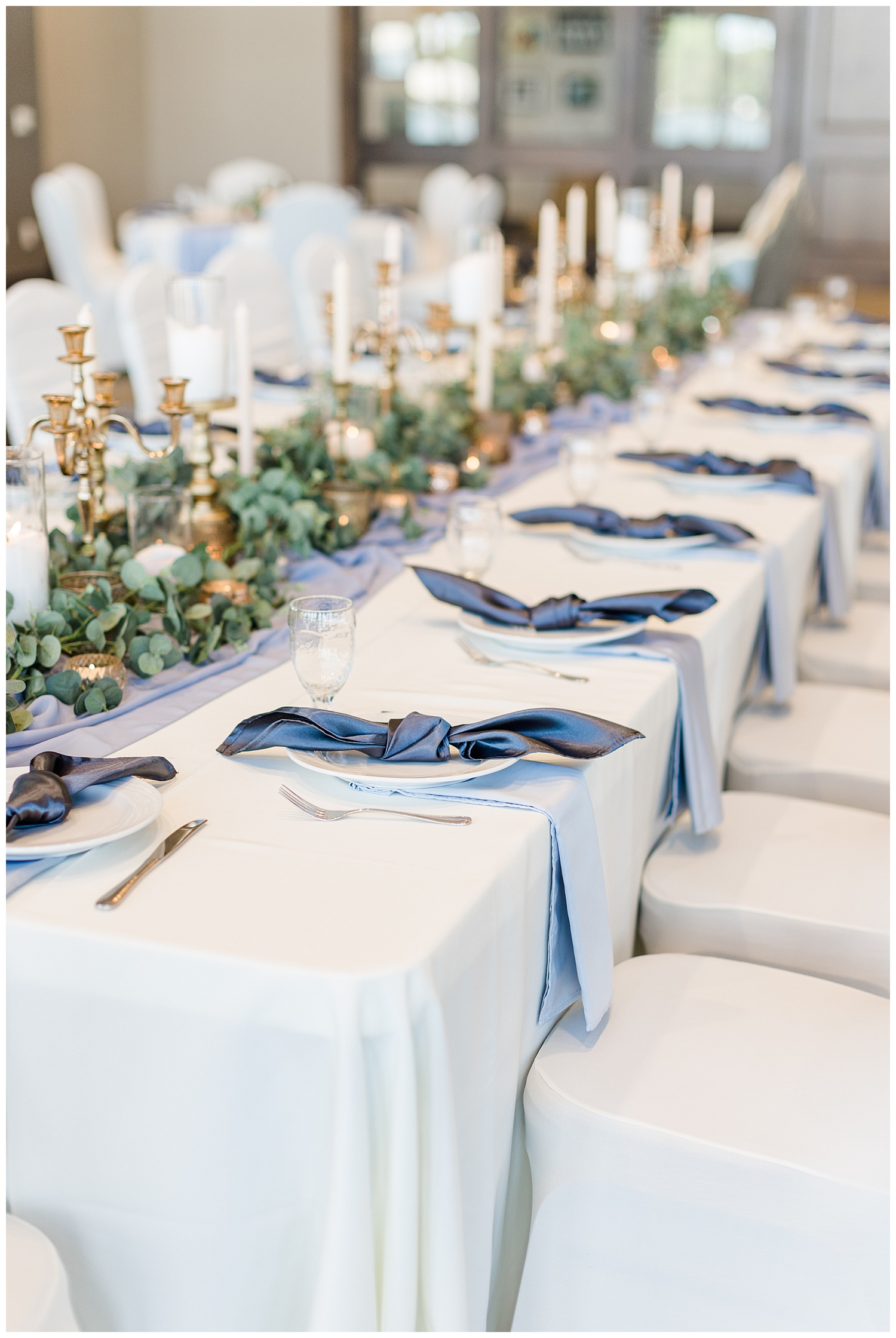 Dusty blue and peach kings wedding table topped with gold vintage candlesticks, eucalyptus and knotted napkins at the Shores at Five Island | CB Studio