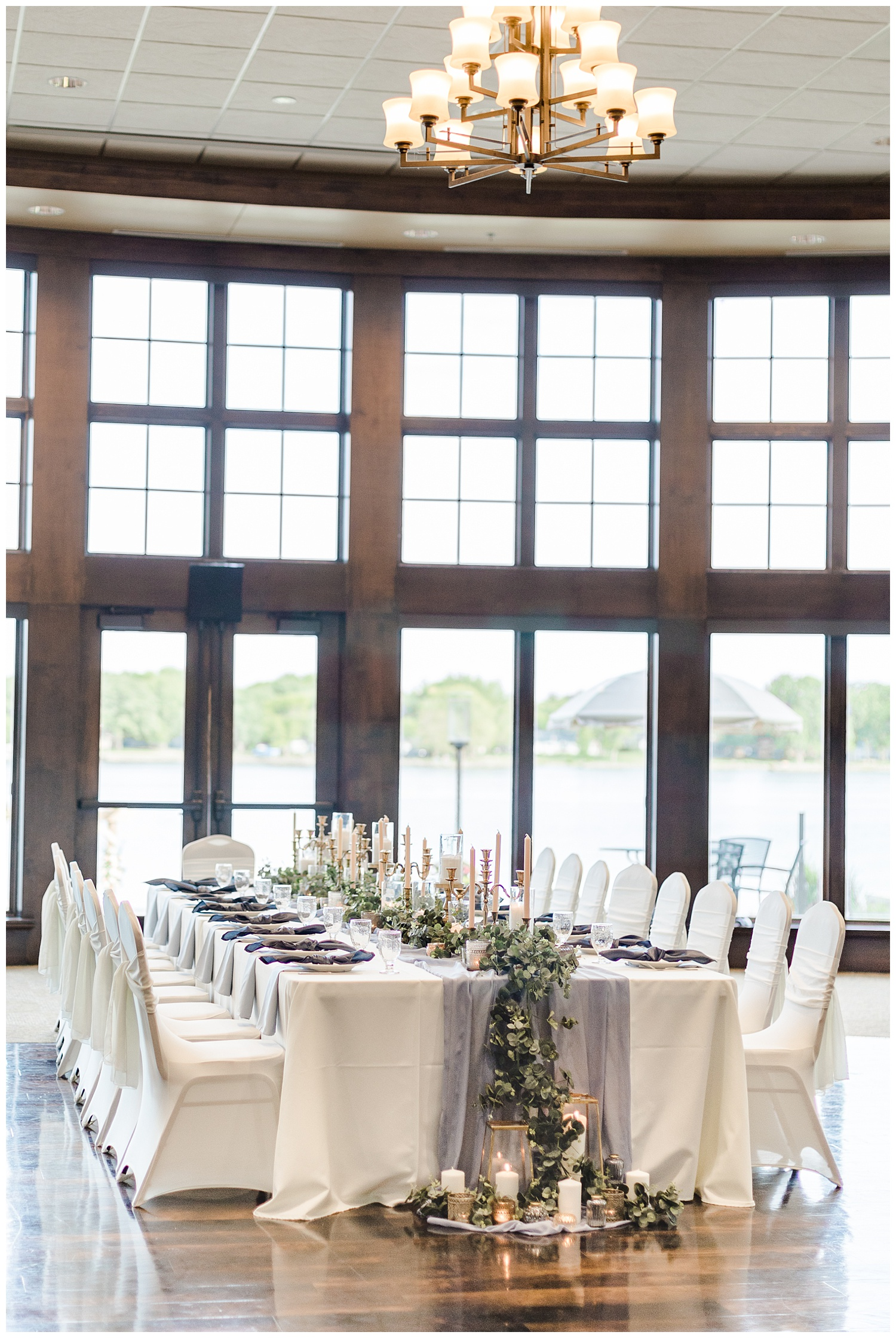 Dusty blue and peach kings wedding table topped with gold vintage candlesticks and eucalyptus at the Shores at Five Island | CB Studio