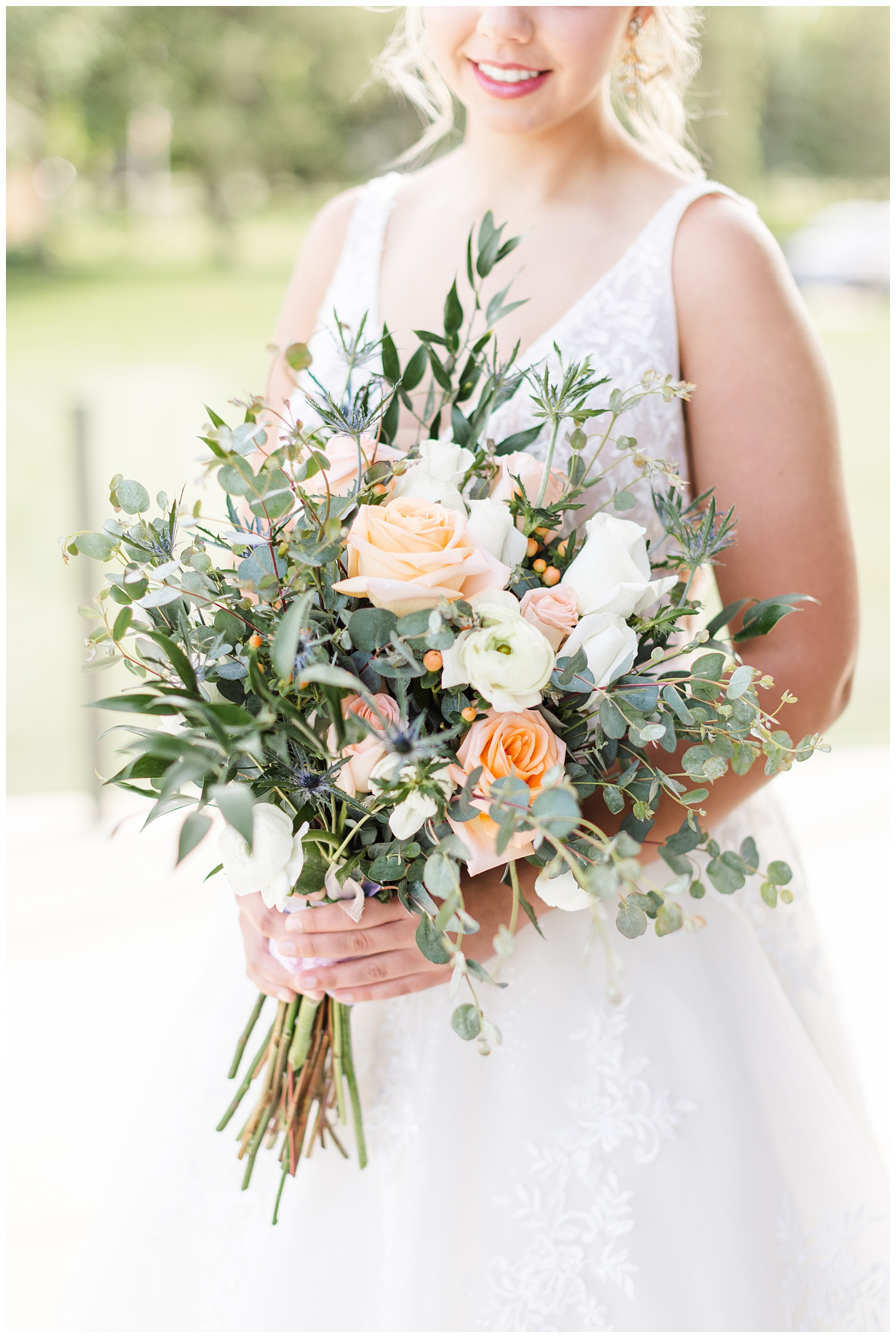 Peach and white rose wedding bouquet with white ranunculus and eucalyptus | CB Studio