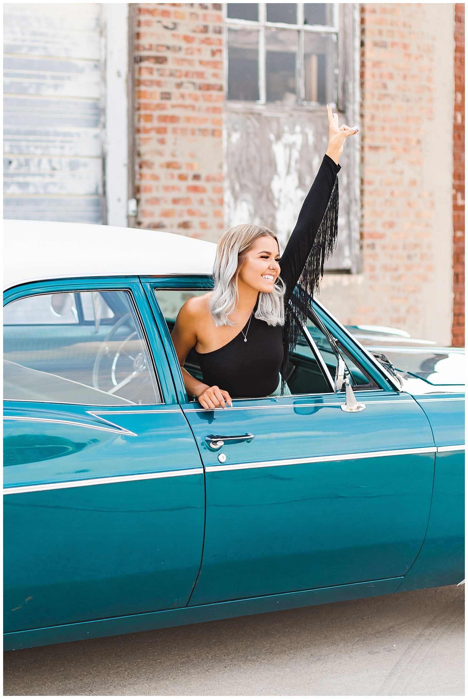 Addison throws a peace sign out of the window of a teal 1967 Chevy Bel Air   CB Studio