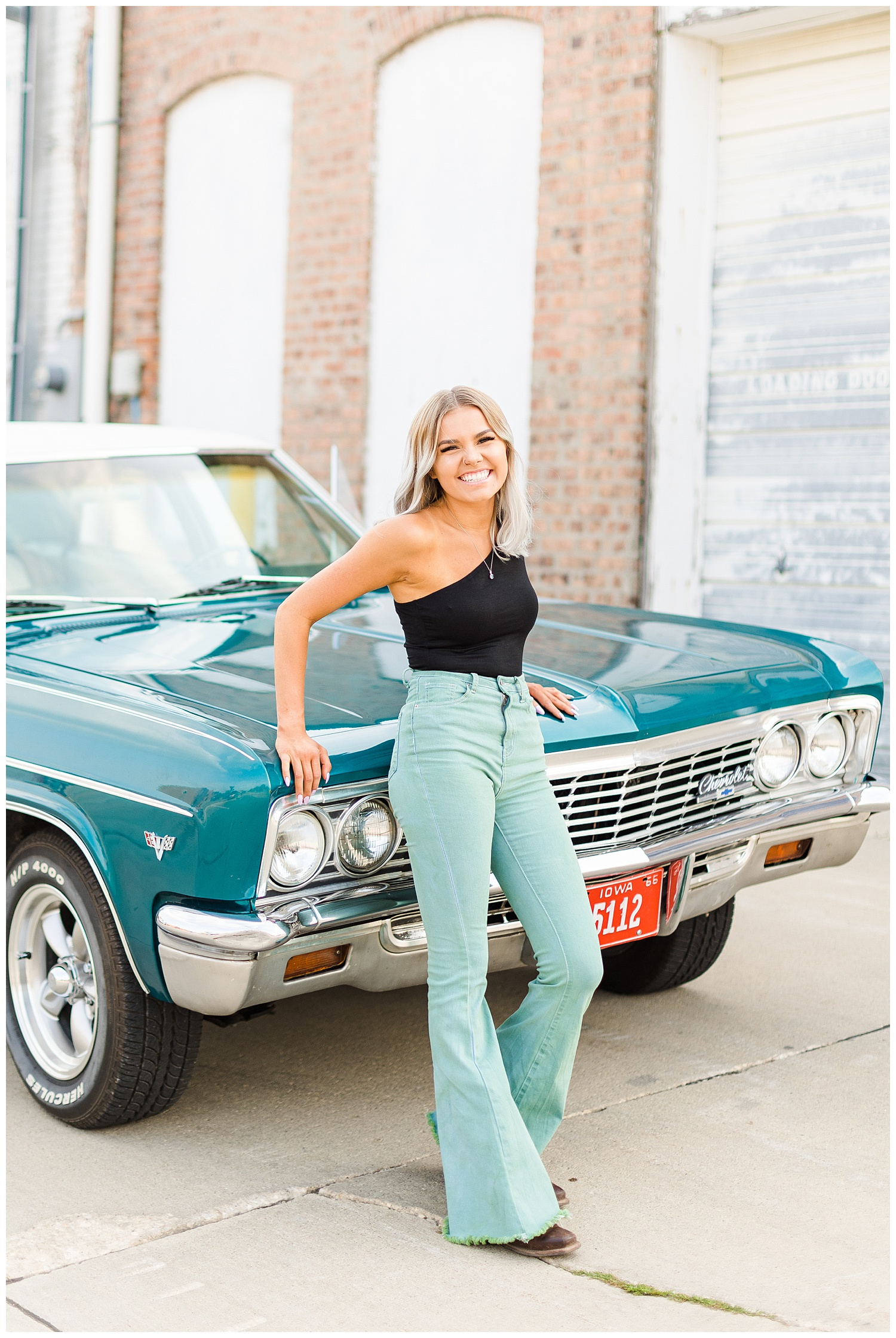 Addison laughs as she leans against a teal 1967 Chevy Bel Air   CB Studio