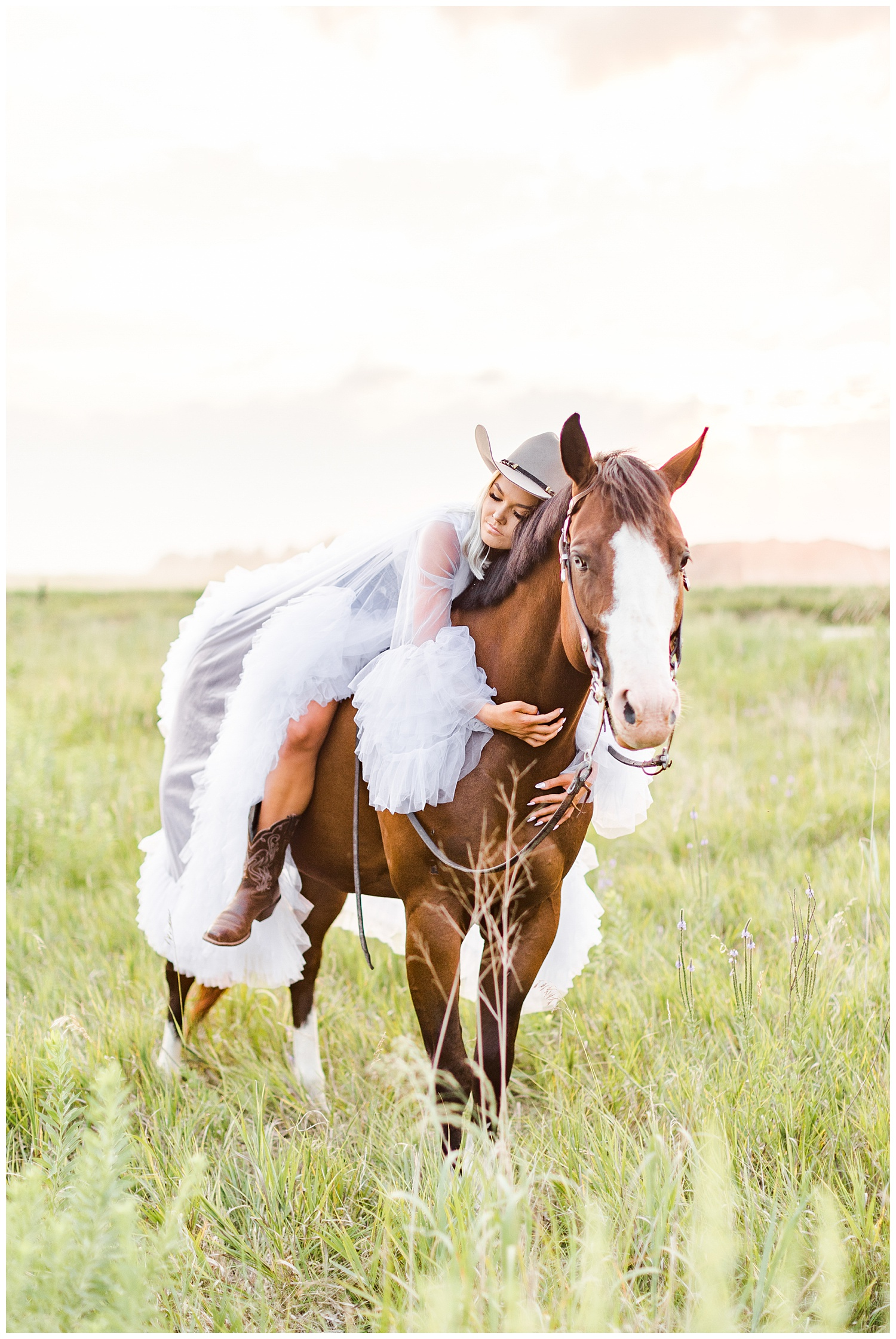 Addison wearing a puffy tulle dress snuggles Miss Flirty the horse in a grassy field   CB Studio