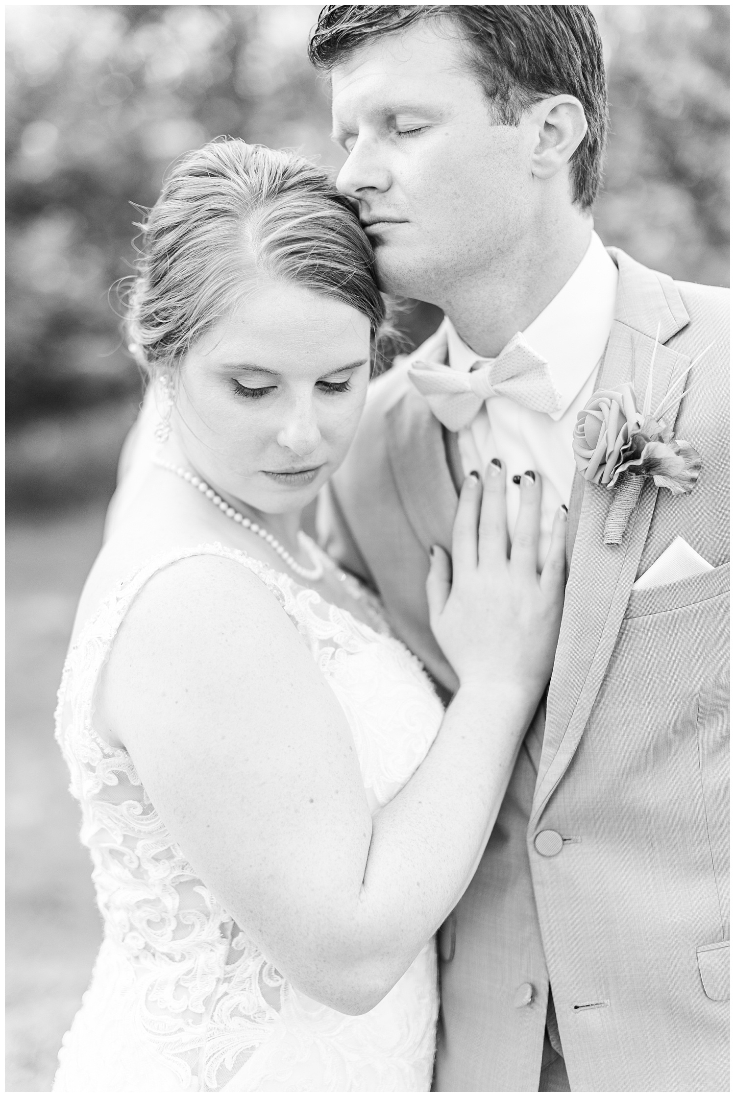 Chris and Hannah embrace each other on their wedding day in Spirit Lake Iowa | CB Studio
