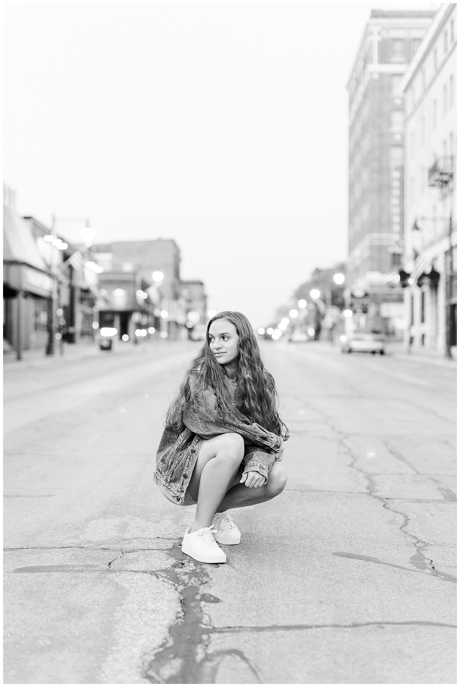Senior Kennedy sits in the middle of the street in downtown Fort Dodge   CB Studio