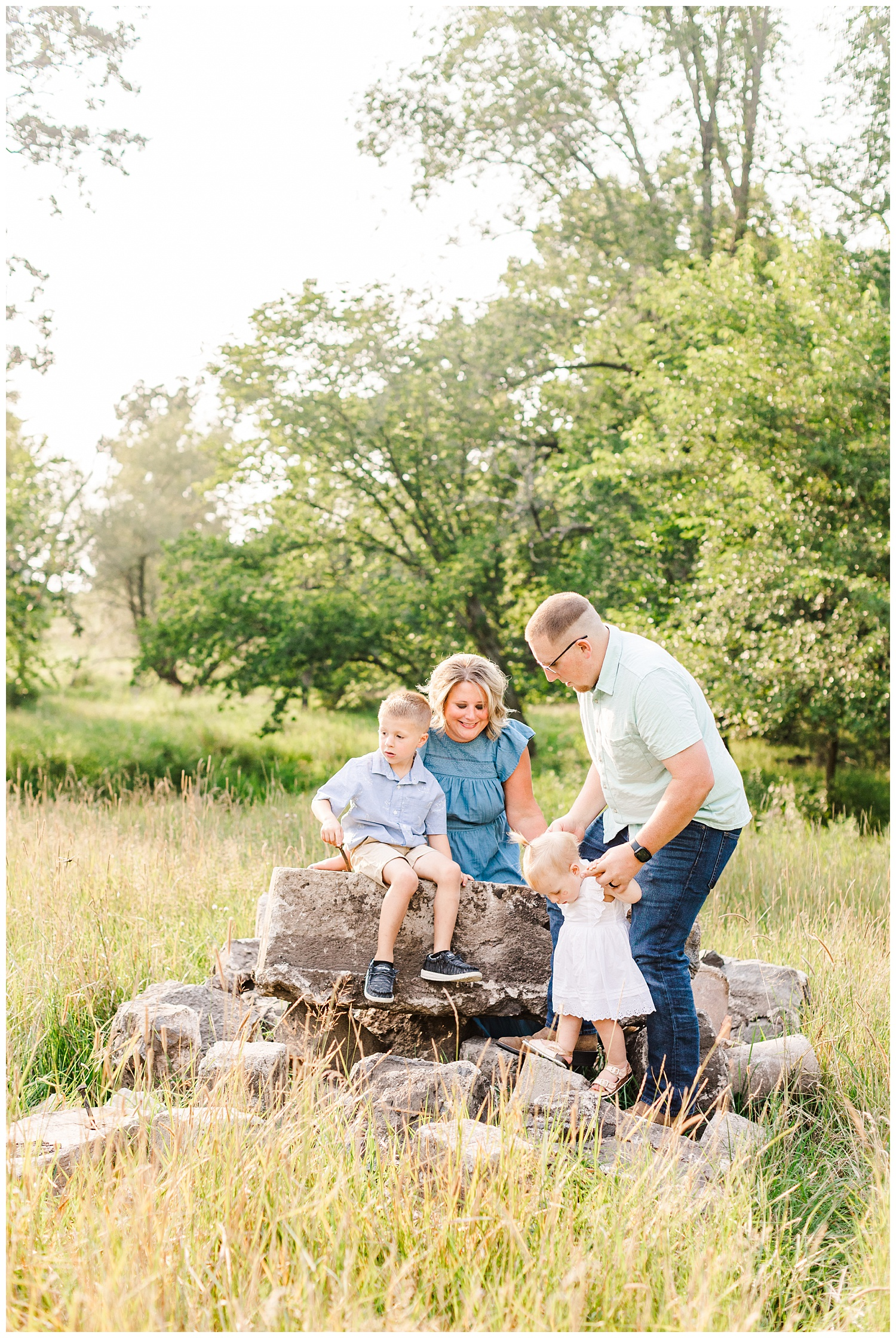 The Bruhn family play together in a grassy pasture in Iowa | CB Studio