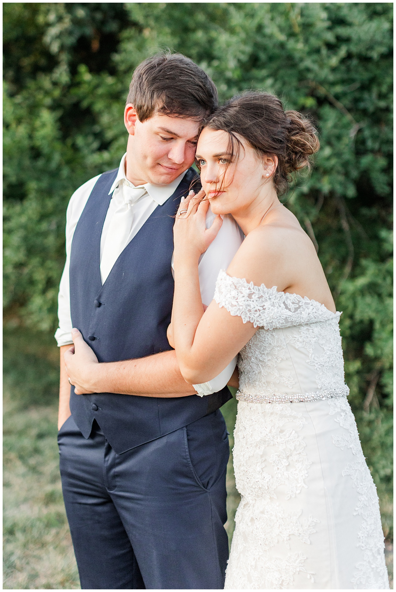 Bride and groom embrace as they watch the sunset at The Shores at Five Island   CB Studio