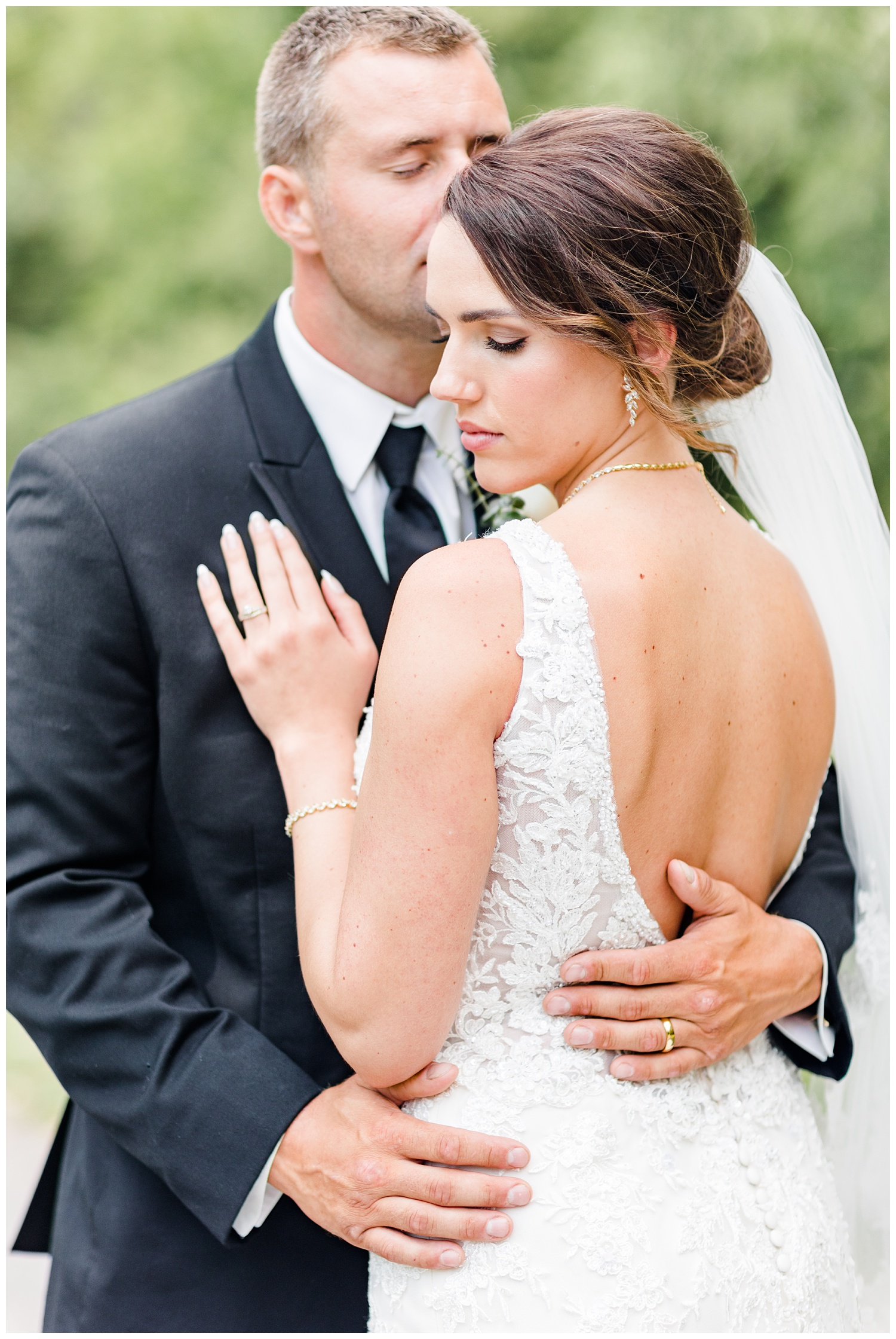 Bride and groom, Renee and Cody, embrace each other at Call State Park   CB Studio