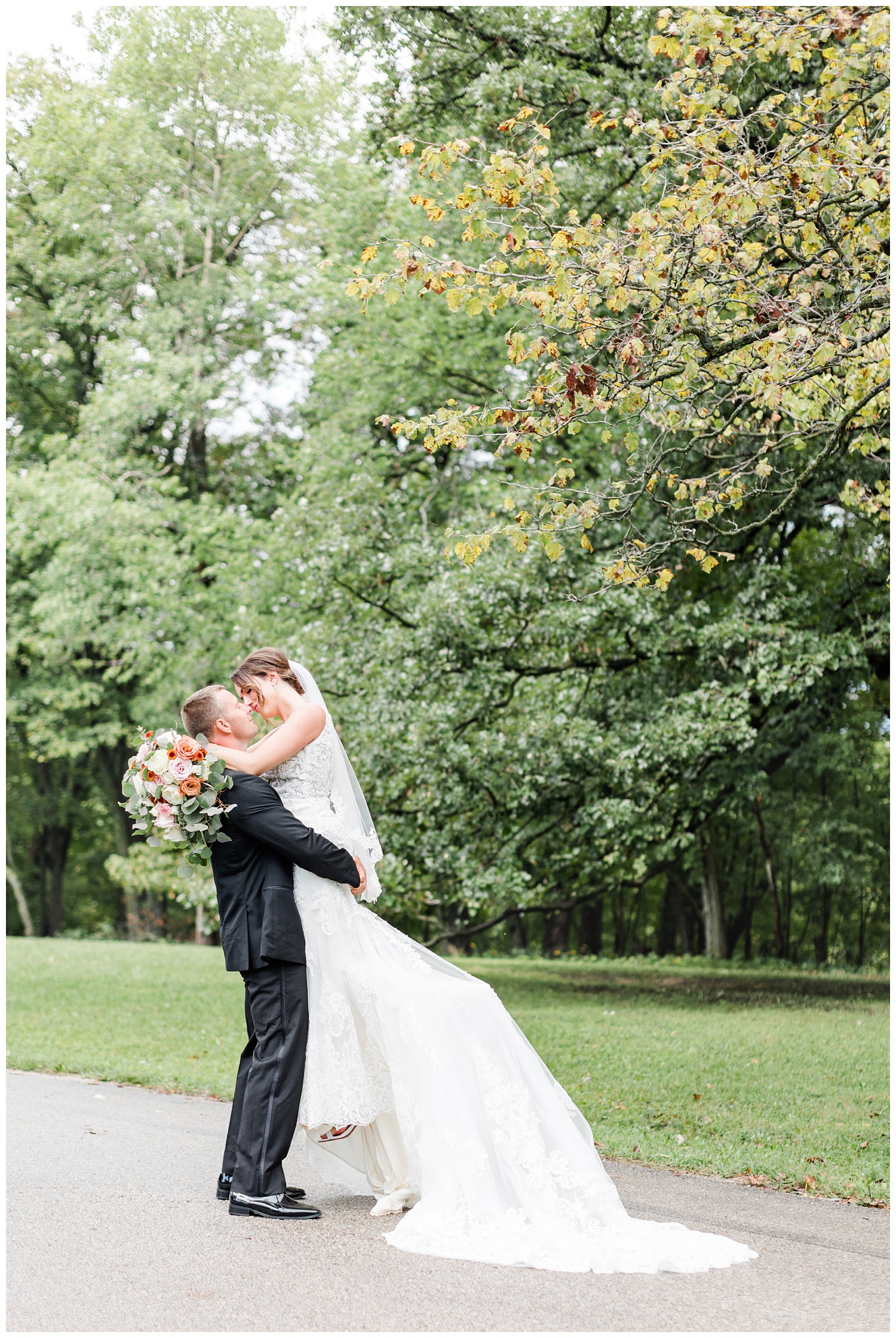 Cody lifts his bride up for a kiss along a path at Call State Park before their wedding ceremony   CB Studio
