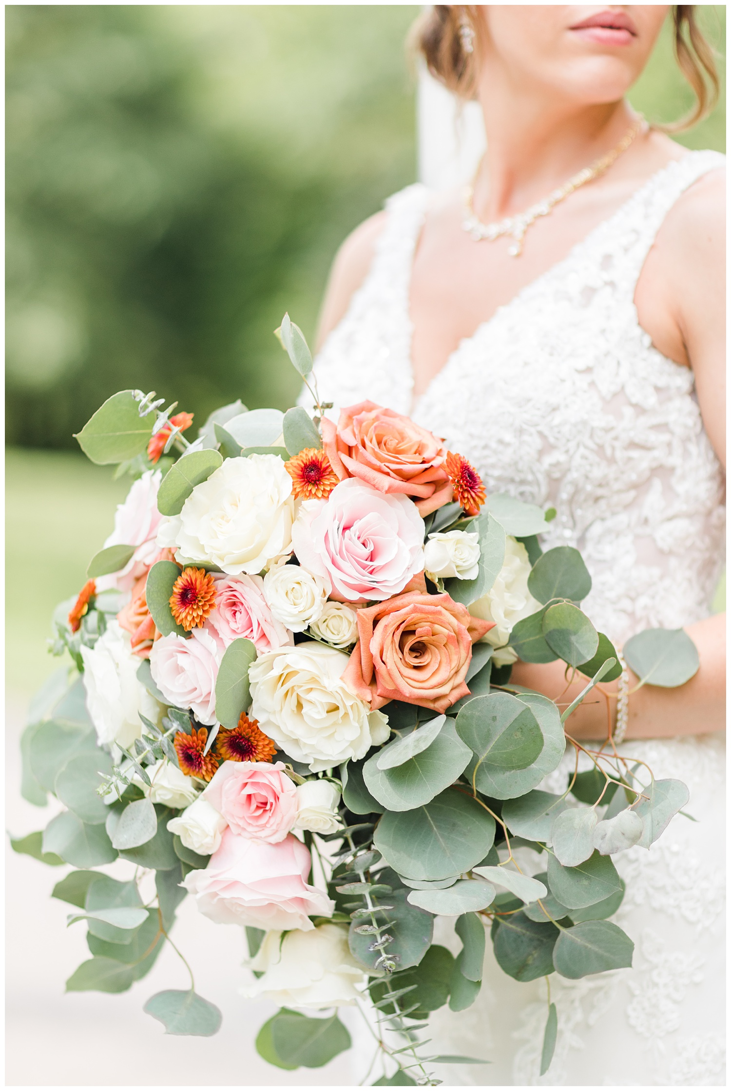 Renee's bridal bouquet featuring white, light pink and dusty orange roses as well as eucalyptus   CB Studio