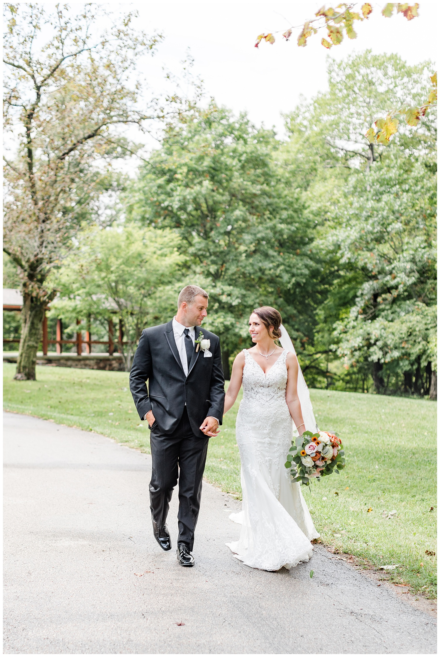 Bride and groom, Renee and Cody, walk along a path at Call State Park before their wedding ceremony   CB Studio