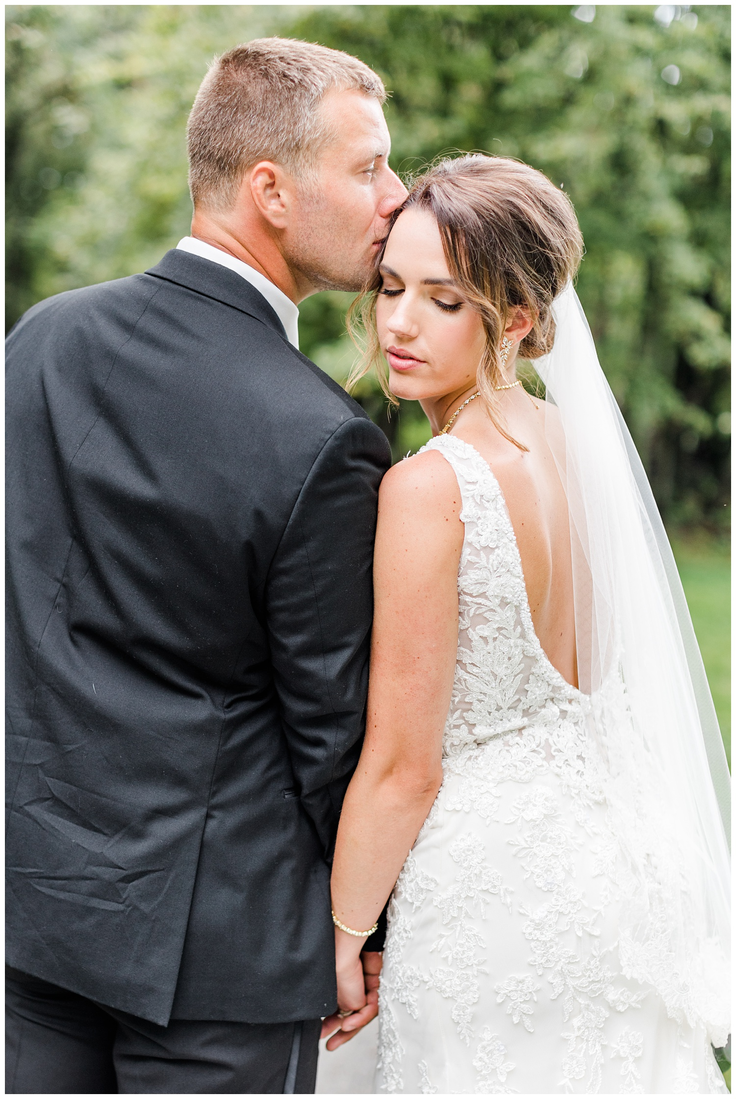 Cody kisses his bride Renee on the forehead at Call State Park before their wedding ceremony   CB Studio