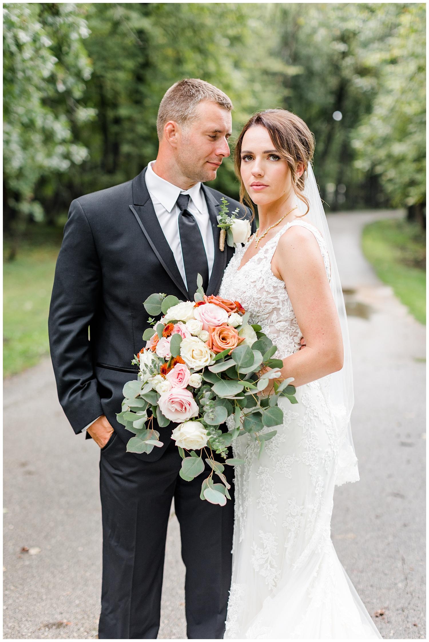 Cody gazes at his bride lovingly along a path at Call State Park   CB Studio