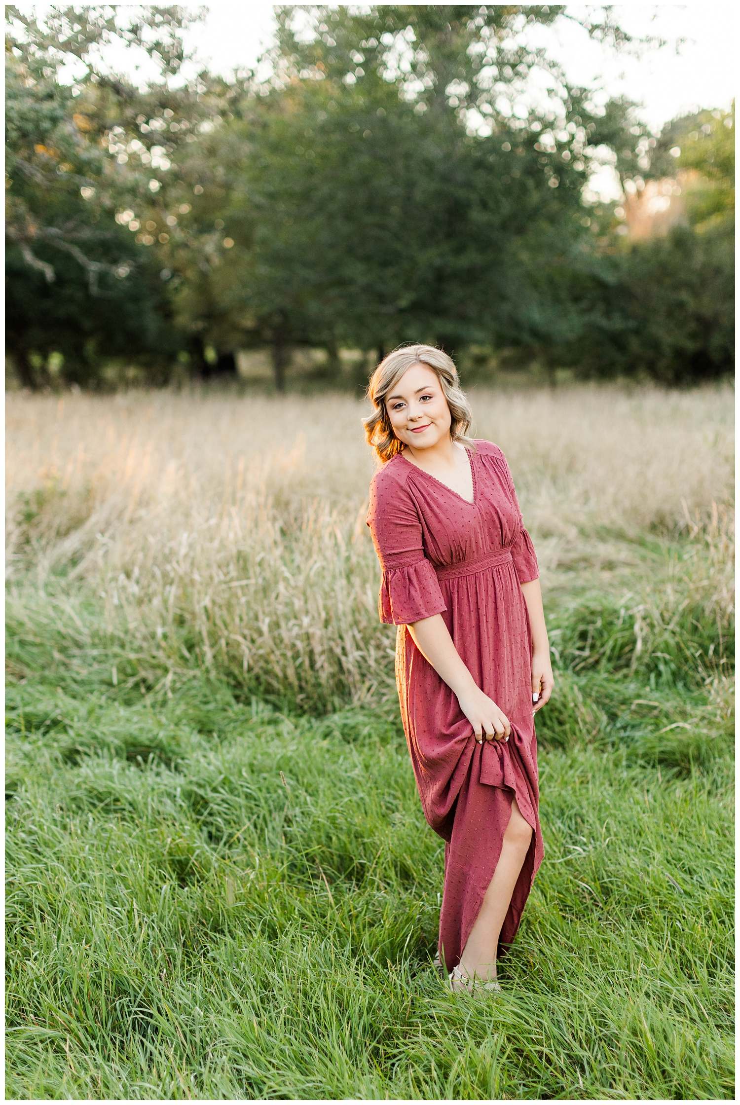 Cloey, wearing a vintage red dress, stands in a grassy pasture at golden hour   CB Studio