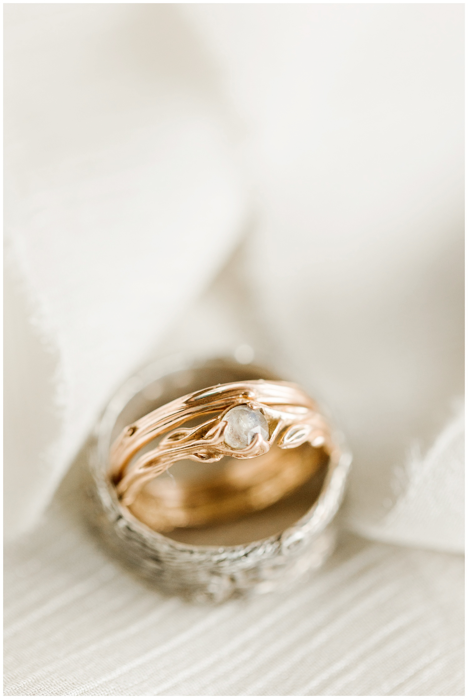 Hippie unity wedding band featuring a rose gold twig and leaf band and a center moonstone   CB Studio