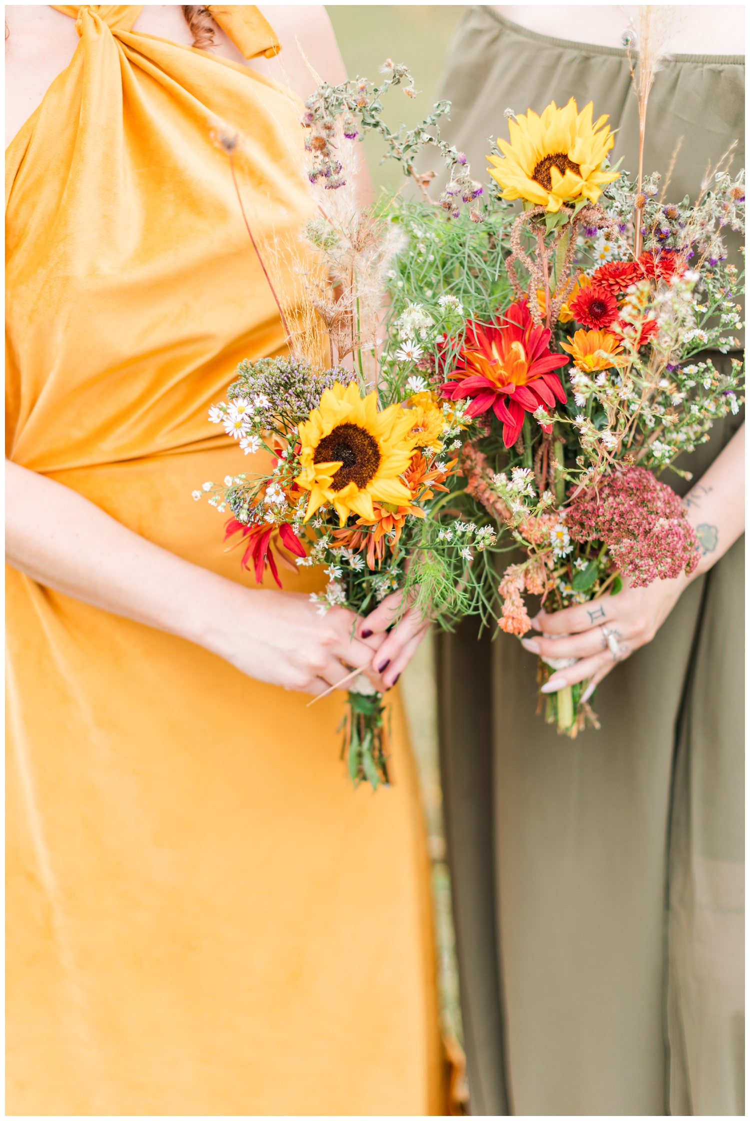 Fresh picked wildflower wedding bridesmaids bouquets featuring sunflowers, mums, cattail, Queen Anne's lace and pampas grass   CB Studio