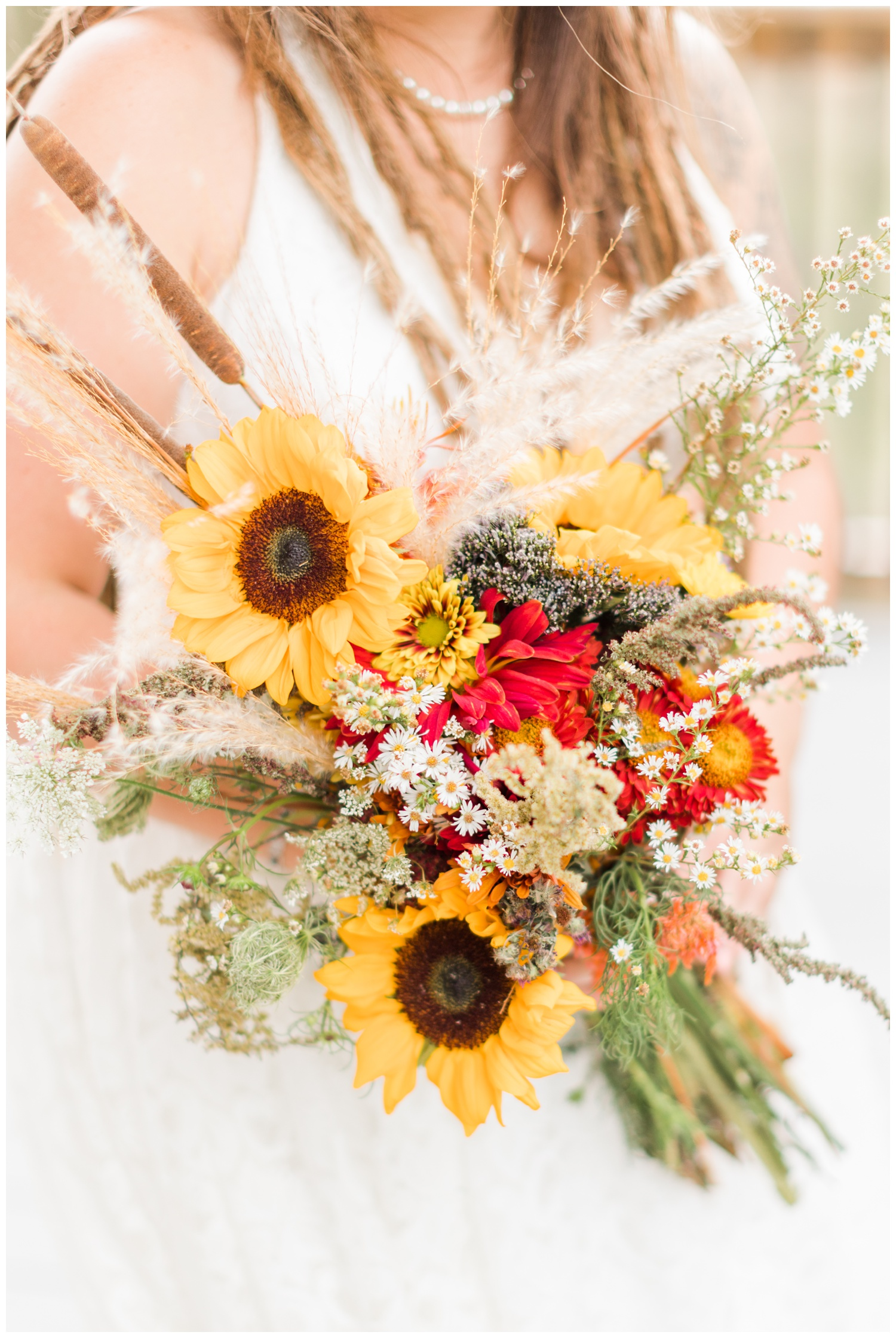 Fresh picked wildflower wedding bouquet featuring sunflowers, mums, cattail, Queen Anne's lace and pampas grass   CB Studio