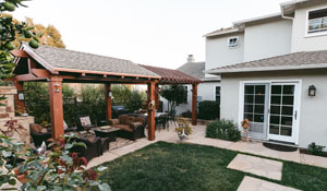 Contemporary Backyard Pergola with Fireplace