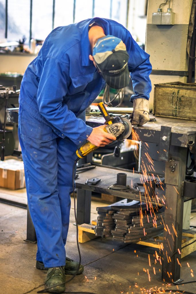 Worker in metalsmithing shop