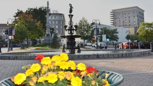Drum Country Water Fountain and Flowers