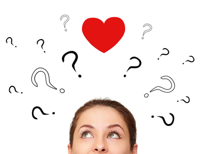 Girl thinking about love with many questions and heart above head