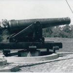 CCC enrollees retrieved a 32 pound artillery piece from the river.