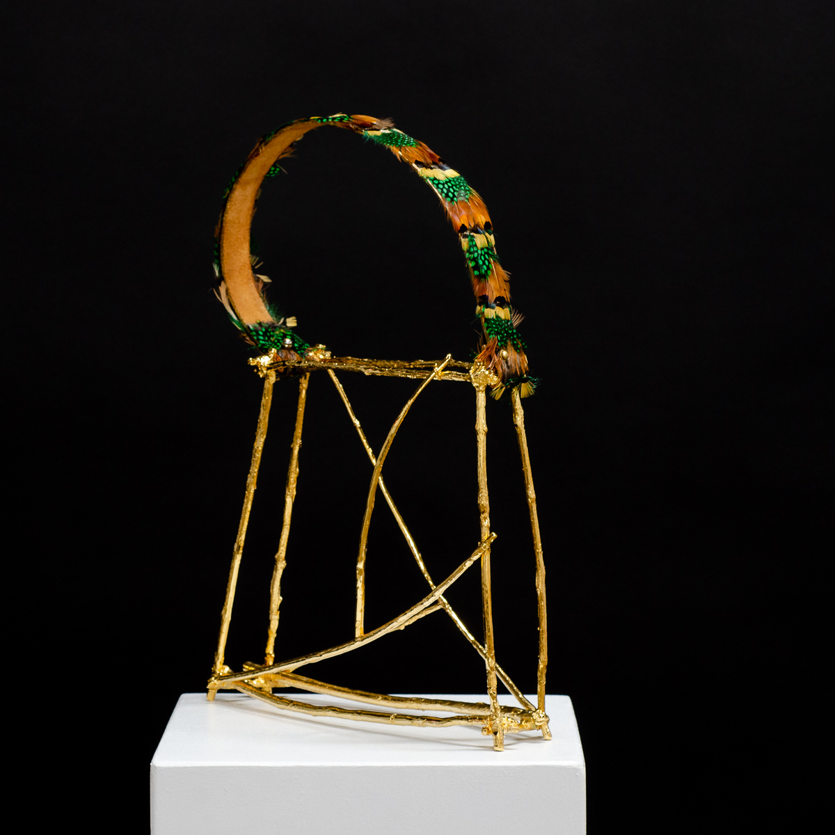 Sculpture by Beatriz Gerenstein. Handbag made in Bronze, 24K Gold, and exotic feathers