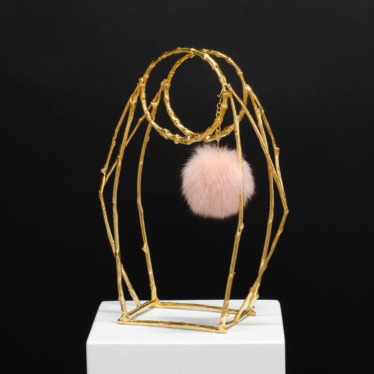 DARONA, Sculpture by Beatriz Gerenstein. Handbag made in Bronze, 24K Gold plating, with a pinky fur pom-pom.