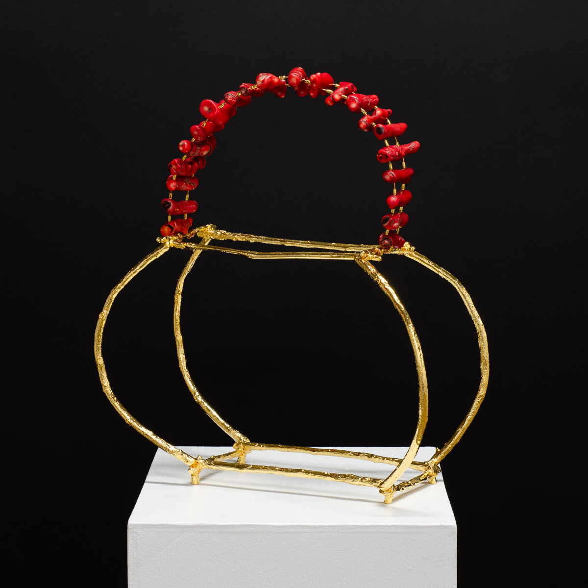 GINGER, Sculpture by Beatriz Gerenstein. Handbag made in Bronze, 24K Gold plating,, and red corals.