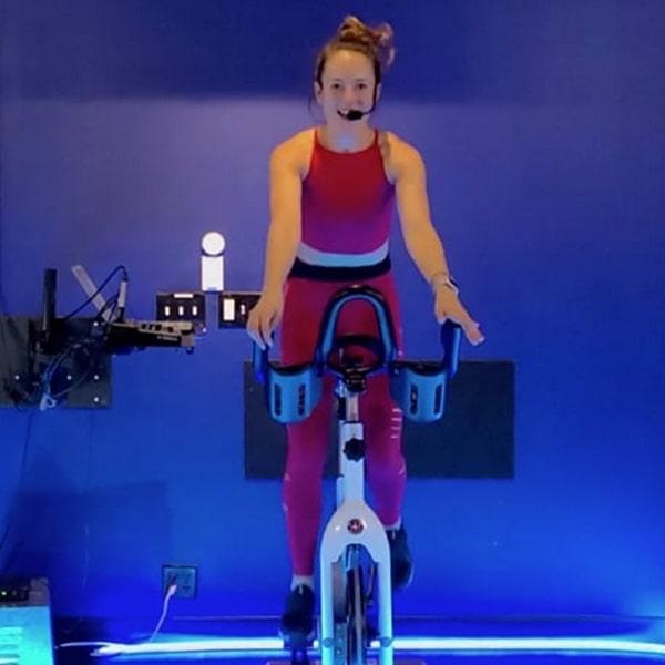 Lauren cycling in virtual cycling class