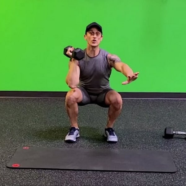 Ryan doing a squat holding dumbell