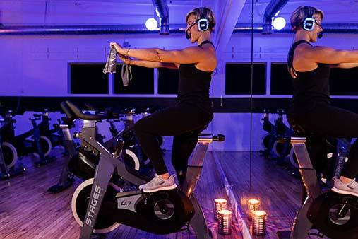 Sarah DeGray teaching indoor cycling class