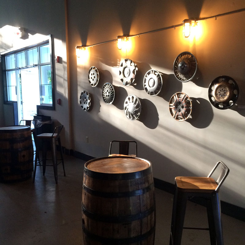 Evolving Painted Hub Cap Wall at Brewery Legitimus