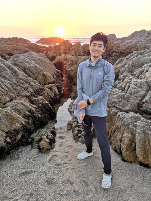 Rui in front of tidepool at sunset