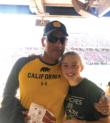 Troy with friend's daughter at a sport arena
