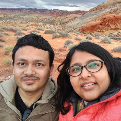 Tirtha & Chitrita in front of scrubland